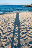 Male shadow on the beach Stock Photos