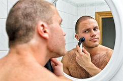 Male shaving. In bathroom in front of the mirror Royalty Free Stock Photos