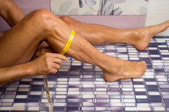 Male shin measures. Adult male tanned measures shin Stock Photo