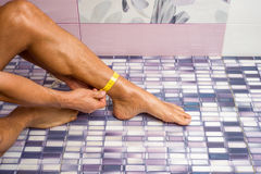 Male shin measures. Adult male tanned measures shin Royalty Free Stock Photography