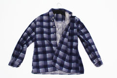 Male Shirt on a Hanger. A thick male shirt with long sleeves on a hanger, isolated on plain background Royalty Free Stock Photos
