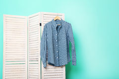 Male shirt. Hanging on folding screen on a green background Royalty Free Stock Image