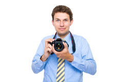 Male in shirt and tie holds dslr camera, isolated. Young businessman in blue shirt and necktie holds dslr camera, studio shoot isolated on white background Stock Images
