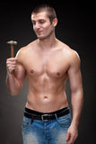 Male shirtless standing with hammer Stock Photo