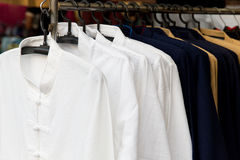 Male shirts on hanger at asian street market Stock Image