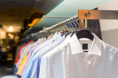Male shirts on the rack Stock Image