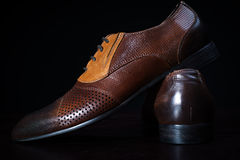 Male Shoe on Solid Black Background Royalty Free Stock Photos