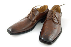 Male shoes. Brown male shoes on isolated Royalty Free Stock Photo