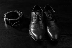 Male shoes and belt in black and white. Color Stock Photo