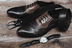Shoes with belt and watch. Male shoes with belt and watch Stock Photos
