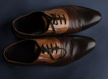 Male shoes. Male brown shoes over dark Stock Photography