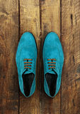 Male shoes on a brown wooden Royalty Free Stock Photos