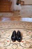 Male Shoes on Carpet. Black male wedding shoes on carpet Royalty Free Stock Image