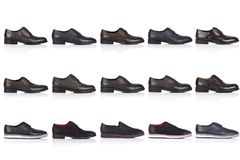 Male shoes collection on a white background, with a shadow on a glossy surface. Front view. 15 pieces Royalty Free Stock Image