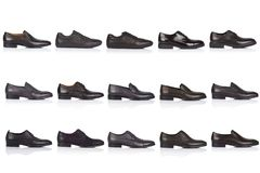 Male shoes collection on a white background, with a shadow on a glossy surface. Front view. 15 pieces Royalty Free Stock Photo