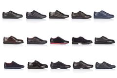 Male shoes collection on a white background, with a shadow on a glossy surface. Front view. 15 pieces Stock Photography