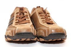 Male shoes. Frontal view of male shoes over white background Stock Images