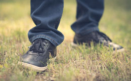 Male shoes in the green grass. Retro view Royalty Free Stock Photos