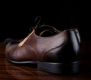 Male shoes over black. Background Royalty Free Stock Photos