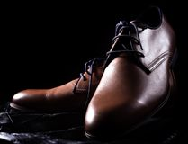 Male shoes over black. Fashion accessories. Male shoes over black Stock Photos