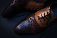 Male shoes over dark background. Brown male shoes over dark background Royalty Free Stock Photography