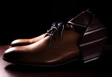 Male shoes with tie. Over black Stock Images
