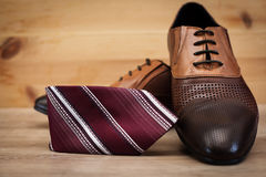 Male shoes and tie. Man`s style. Male shoes and tie Royalty Free Stock Photo