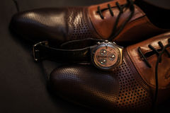 Male shoes and watch. Classic male shoes and watch Stock Photos