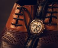 Male shoes and watch. Closeup male shoes and watch Stock Photo