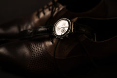 Male shoes and watch. Man`s style. Male shoes and watch Stock Photography