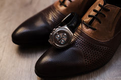 Male shoes and watch. Man`s style. Male shoes and watch Stock Images