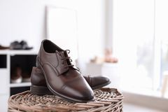 Male shoes on wicker stand. In store Stock Photos
