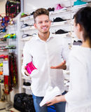 Male shop assistant helping customer Stock Images