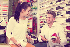 Male shop assistant helping customer Stock Photography