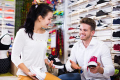 Male shop assistant helping customer Royalty Free Stock Photo
