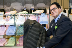 Male shop assistant with suit jacket Stock Photo