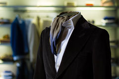 Male shop. Detail of male costume in the store Stock Image