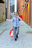 Male with shopping bags Royalty Free Stock Photography