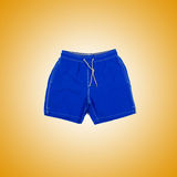 Male shorts against the gradient background Stock Image