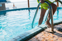 Male in shorts at pool. Male in shorts at swimming pool during day Royalty Free Stock Photos
