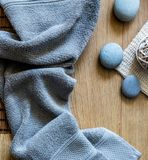Male shower and healthy bath minimalist concept with grey towel. Male fresh shower and healthy bath minimalist concept with grey towel, zen pebbles over wooden Stock Photos