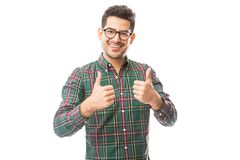 Male Showing Approval Gesture With Thumbs Up. Portrait of young male showing approval gesture with thumbs up over white background stock photography