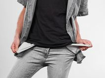Male showing empty pockets. Financial difficulties, bad economy, no money concept. Young man student boy showing empty pockets, part of body male hips wearing Royalty Free Stock Image