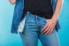 Male showing empty pockets. Financial difficulties, bad economy, no money concept. Young man student boy showing empty pockets, part of body male hips wearing Stock Image