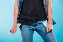 Male showing empty pockets. Financial difficulties, bad economy, no money concept. Young man student boy showing empty pockets, part of body male hips wearing Stock Images