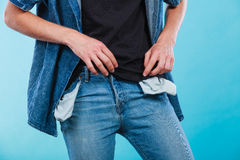 Male showing empty pockets. Financial difficulties, bad economy, no money concept. Young man student boy showing empty pockets, part of body male hips wearing Royalty Free Stock Photography