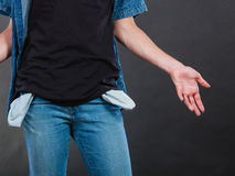 Male showing empty pockets. Financial difficulties, bad economy, no money concept. Young man student boy showing empty pockets, part of body male hips wearing Royalty Free Stock Photo