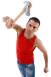 Male showing hammer. Against white background Royalty Free Stock Photography