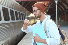 Male showing impatience at the station stock photos