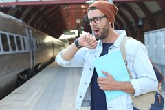 Male showing impatience at the station Royalty Free Stock Photos